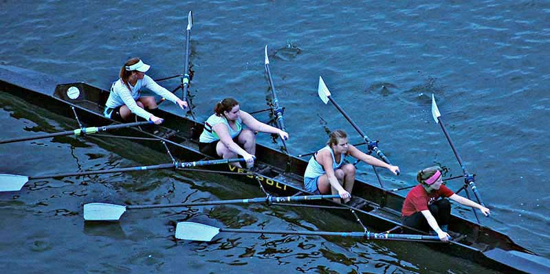 4 girls learning to row